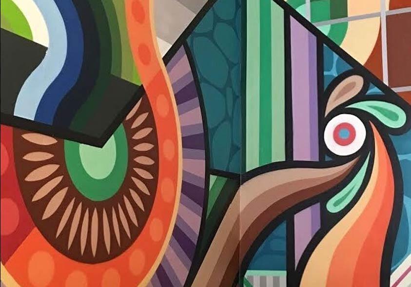 este ejemplo de graffiti geométrico muestra líneas recatas y curvas y colores muy exóticos, este mural se realizó en Madrid en 2006