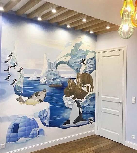 En esta fotografía podemos ver un mural de naturaleza realizado en un dormitorio infantil